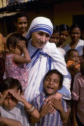 19 Oct 1979, Calcutta, India --- Mother Teresa with children from the orphanage she operated in Calcutta. Mother Teresa (Agnes Gonxha Boyaxihu) the Roman Catholic, Albanian nun revered as India's 'Saint of the Slums', was awarded the 1979 Nobel Peace Prize. --- Image by © Kapoor Baldev/Sygma/CORBIS. *To find out how to sponsor a disadvantaged child's education in India, please go to: www.healcharity.org
