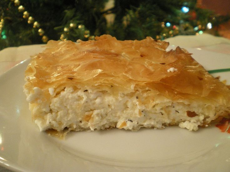 Tyropita (pr. tee- row -pee-ta)  from tyri (cheese) + pita = pie is a Greek pastry made with different cheese fillings and different types of phyllo..