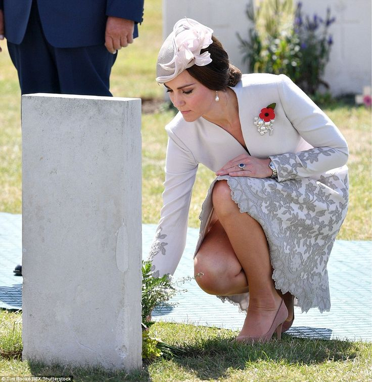 The Duchess of Cambridge laid flowers at war graves in Ypres today during a ceremony marki...