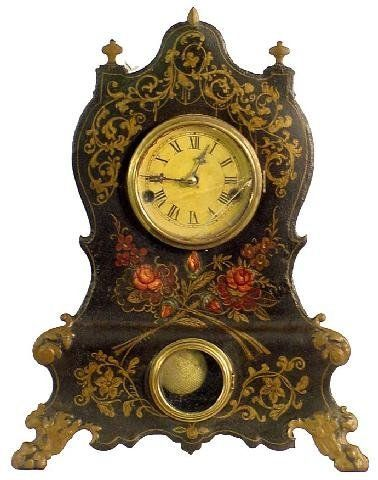 This is a Victorian clock. It is an example of what a wealthy family in this era might have imported for their house from Europe.