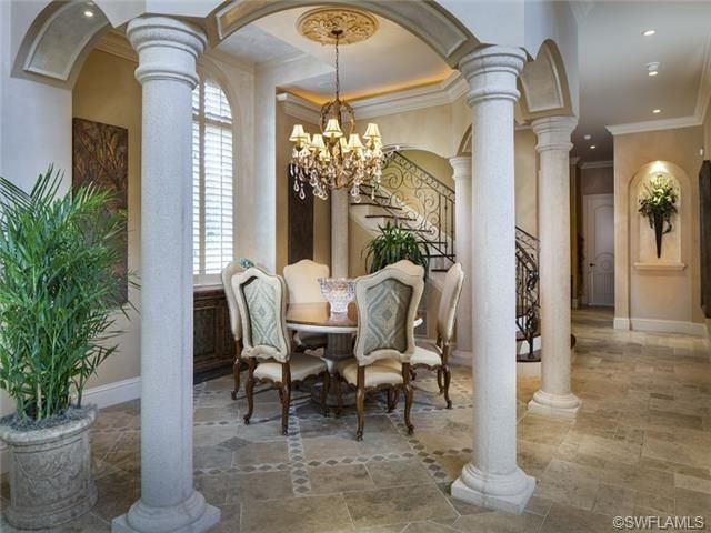 Formal dining room chandelier stone columns port for Formal dining room chandelier