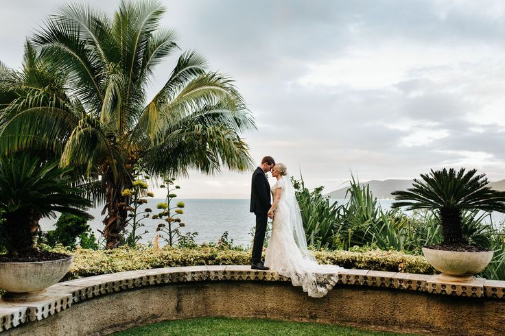 Stunning wedding photo location on our sea wall, surrounded my lush tropical gardens and ocean views! Image by Playback Studios
