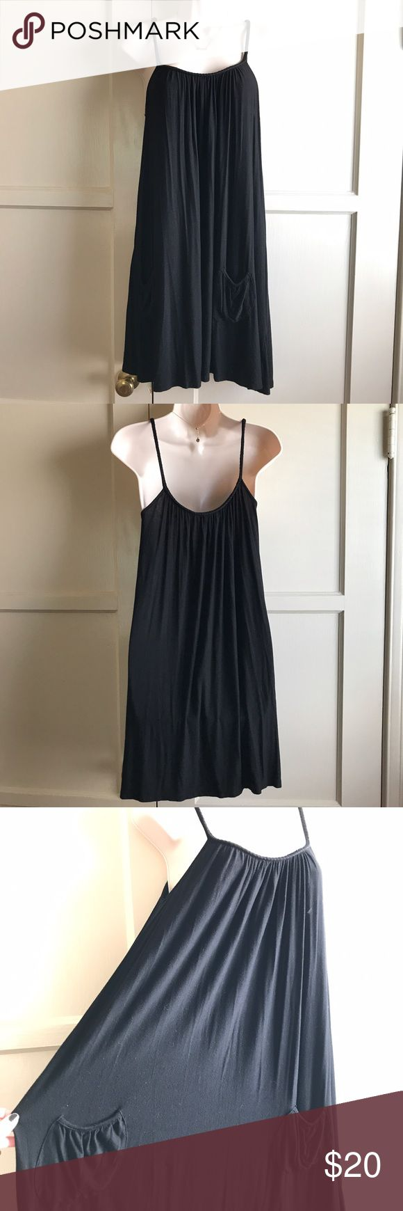BCBGeneration oversized black tank dress Oversized black BCBG BCBGeneration dress WITH POCKETS.                                                                                        Measurements: Bust (armpit to armpit, laying flat) 17 in. Length - 35in. BCBG Dresses Midi