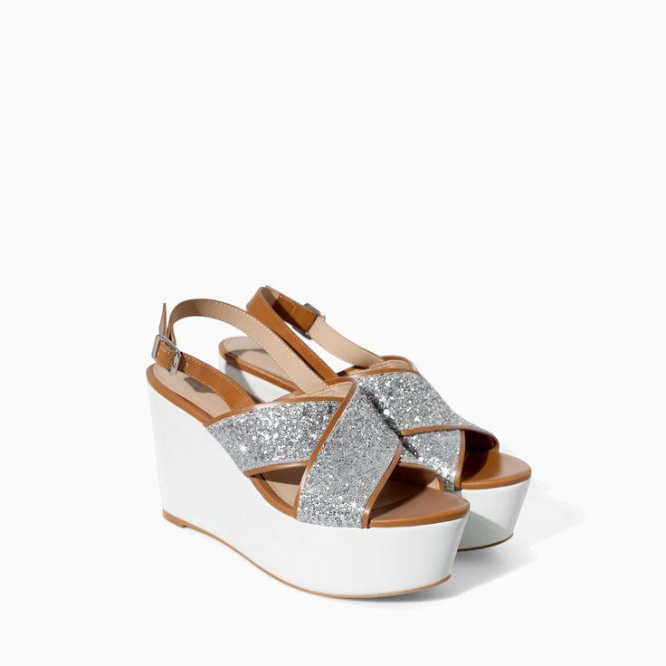 CROSSOVER GLITTER WEDGE - Shoes - TRF - SALE | ZARA Canada Ref. 3524/301 99.90 CAD UPPER 100% POLYURETHANE LINING 100% POLYURETHANE SOLE 100% VULCANIZED RUBBER