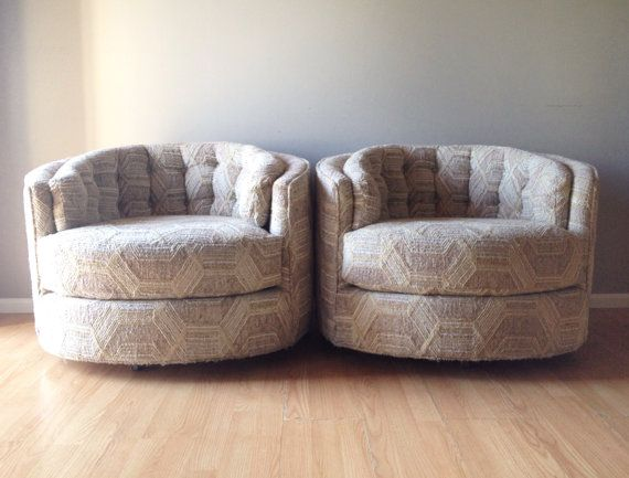 pair of vintage milo baughman style round swivel chairs. mid