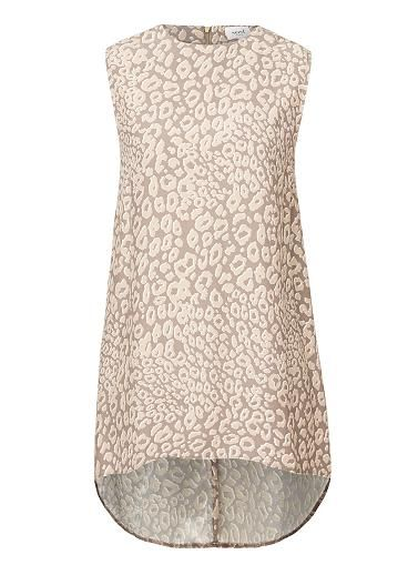 100% Viscose Printed Stepback Tank. Comfortable fitting silhouette features a scoop neck, centre back zipper and swing hem in an all over Cheetah print with dipped hem. Available in Multi as shown.