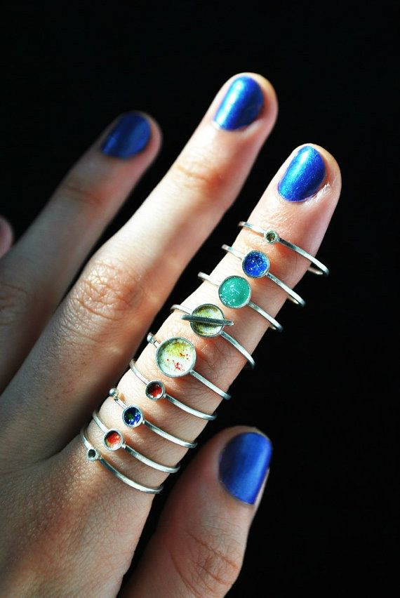 These stackable planet rings:   29 Celestial Accessories You'll Be Over The Moon For
