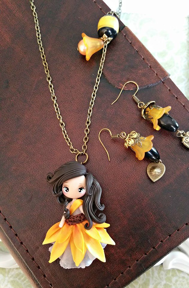Polymer clay sunflower doll pendant