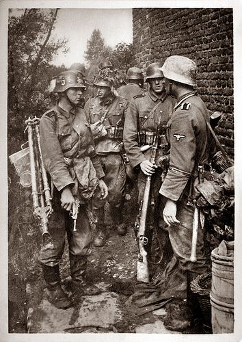 Waffen-SS Regiment Germania. *note the trooper in the left is carrying a MG tripod & holding his Walther P38 pistol.