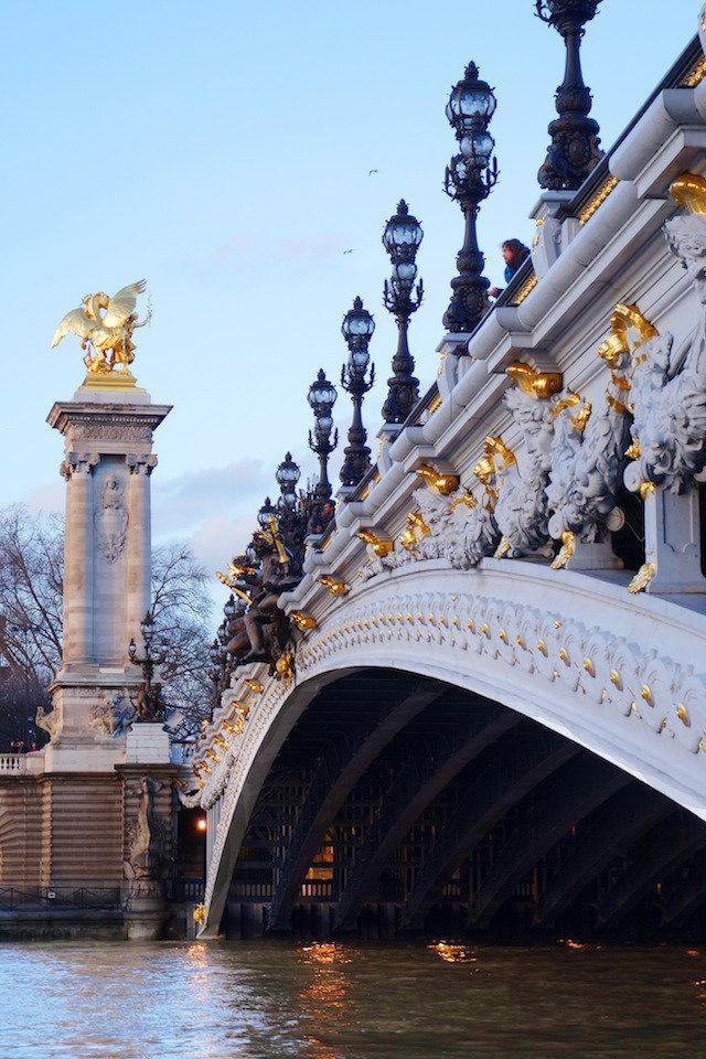 Pont Alexandre III connects Champs-Élysées quarter with those of Invalides & Eiffel Tower & is regarded as most ornate, extravagant bridge in Paris.