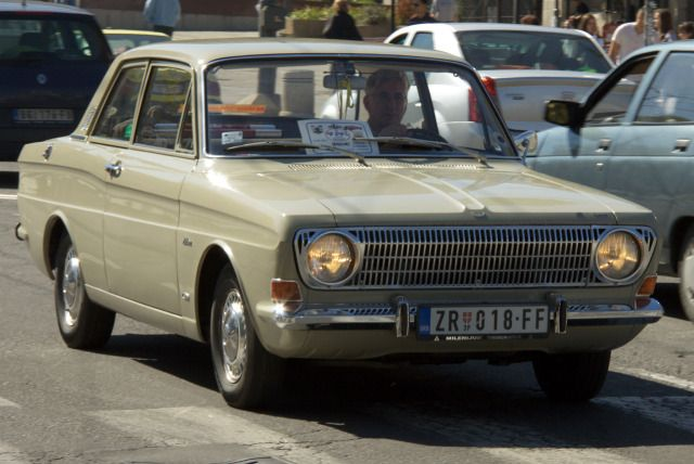 The very first car I remember seeing as a toddler was a Ford Taunus 12M. It was a rather elegant two-tone affair in Prussian blue and a white roof. Back then, young families weren't as spoilt as they are now. The Taunus had two doors – quite sufficient as my sister clambered into the back while I rested safely on my mother's lap in the front seat. Naturally, smoking in the car was de rigeur. A detail I remember was the keyhole to the boot, which was hidden behind a swivelling badge. Très…