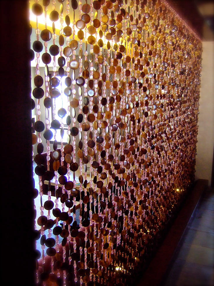 This bead curtain was created for Dubai based World Cuisine Network Restaurants first opening in India (Bangalore). The Interior designer and architect on this project was Kabir Hira.