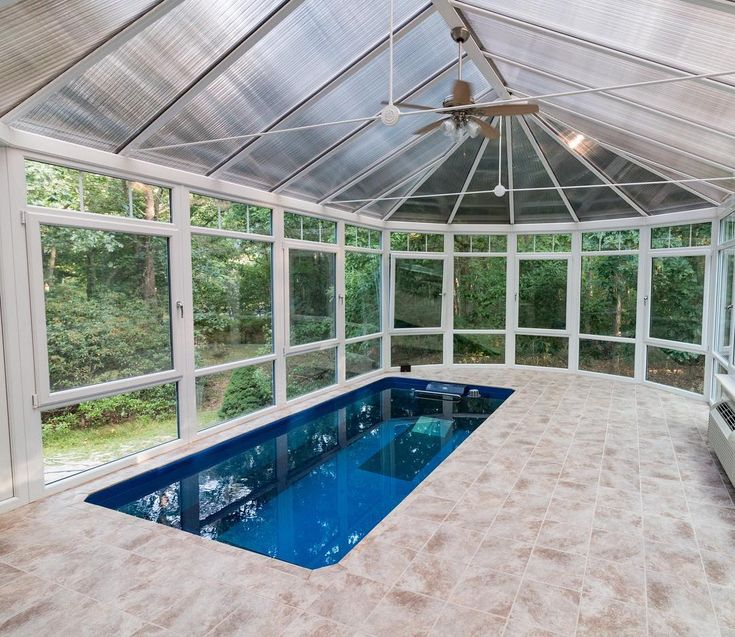 A conservatory for this Endless Pools swimming machine. The homeowners built the addition 6' off the ground to enjoy in-ground luxury with no excavation!