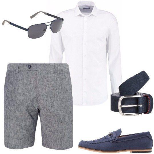 Bermuda dal taglio pulito in tessuto fresco, camicia classica a maniche lunghe, cintura con fibbia in metallo, mocassino con punta tonda, occhiali da sole con lenti color grigio.