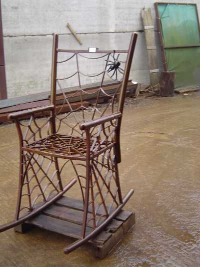 Steel Geometric #sculpture by #sculptor Bob Fuller titled: 'Arachnid Rock (Spider Web Rocking Chair Art statue/Sculptures)' #art