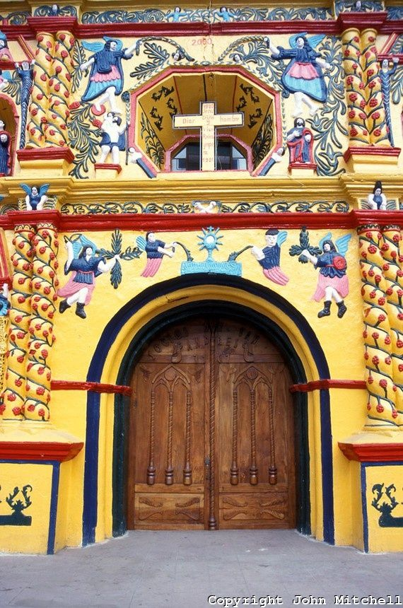 Entranceway of the famous folk baroque church in San Andres Xecul near the city of Quetzaltenango, Guatemala