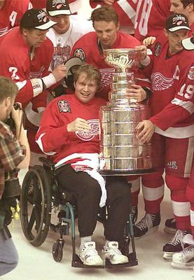 Six days after his Red Wings won the '97 Stanley Cup, defenseman Vladimir Konstantinov was the passenger in a tragic limousine accident. He spent several weeks in a coma and was left permanently paralyzed from the waste down.    When the Wings successfully defended their title and brought home the '98 Cup, they brought Konstantinov onto the ice to celebrate.