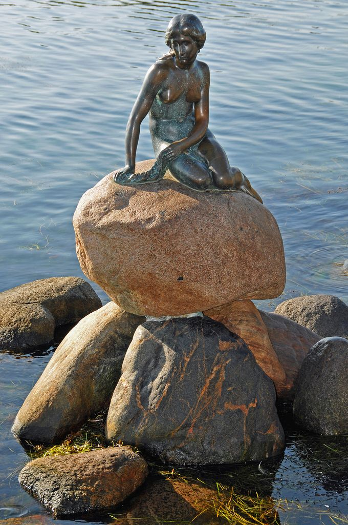 Denmark - the statue of the Little Mermaid in Copenhagen (via archer10). Facts about Denmark: Area: 43,092 sq km. The most southerly of the Scandinavian countries. See separate entries for Faeroe Islands and Greenland, which are autonomous regions of Denmark. Population: 5,481,283. Capital: Copenhagen. Official language: Danish. 13 languages.