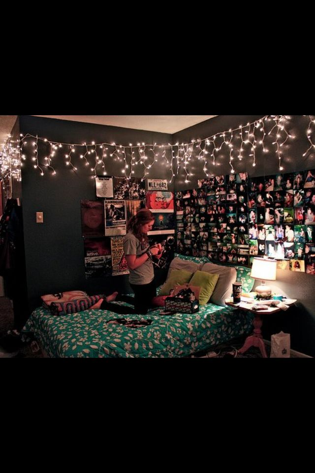 A teenage girl room, with lights, pictures/photos that covers the wall, and a great escape for anyone.