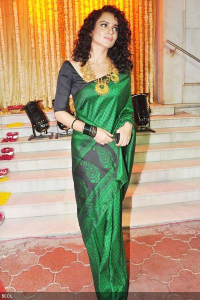Kangna Ranaut at a Wedding in a gorgeous bottle green#Saree & Gold #Necklace ~