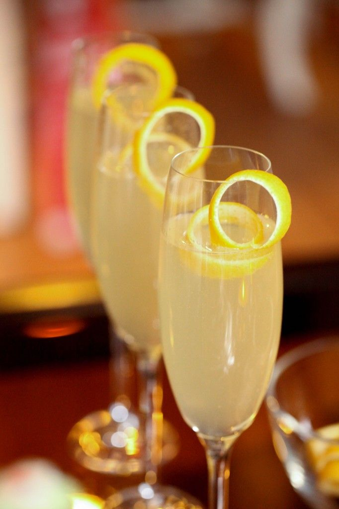 French 75 - 1/2 c simple syrup, 1/2 c gin, 1/2 c lemon juice, 1 bottle champagne, lemon twist.  (simple syrup - equal parts sugar & water)