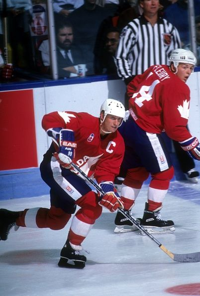 Wayne Gretzky and Theoren Fleury of Team Canada skate on the ice during a 1991 Canada Cup game in September 1991 at the Montreal Forum in Montreal...