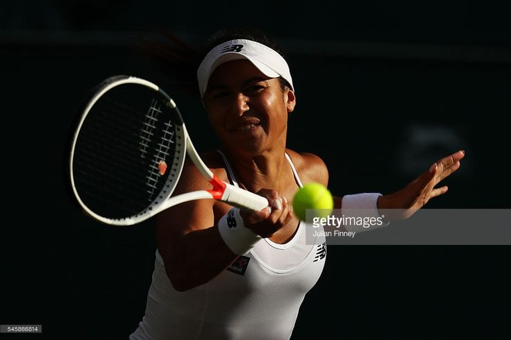Heather Watson of Great Britain (partner of Henri Kontinen of Finland) plays a forehand during the Mixed Doubles Final against Robert Farah of Columbia and Anna-Lena Groenfeld of Germany on day thirteen of the Wimbledon Lawn Tennis Championships at the All England Lawn Tennis and Croquet Club on July 10, 2016 in London, England.