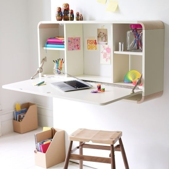 Un escritorio montado en la pared es fácil de guardar. | 41 Clever Organizational Ideas For Your Child's Playroom