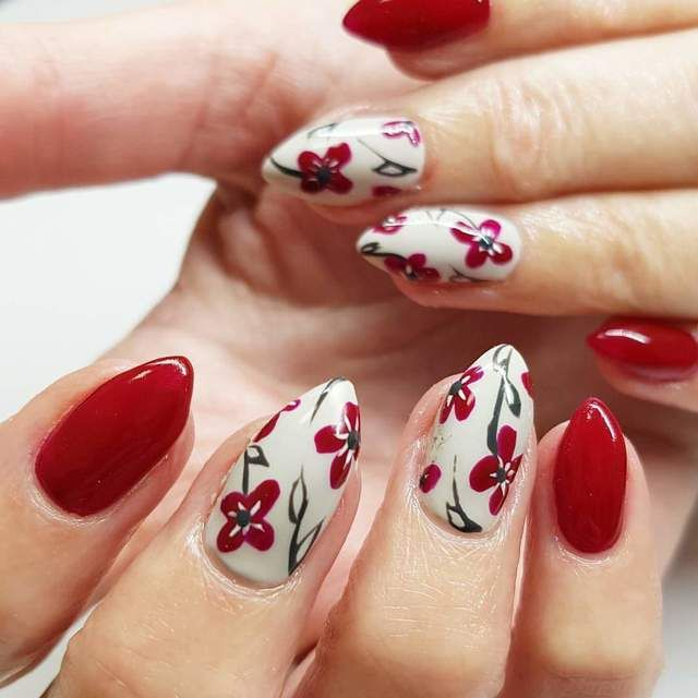 Best 25 almond shaped nail designs ideas on pinterest almond red almond shaped nails with flower accents perfect for spring when the flowers prinsesfo Choice Image