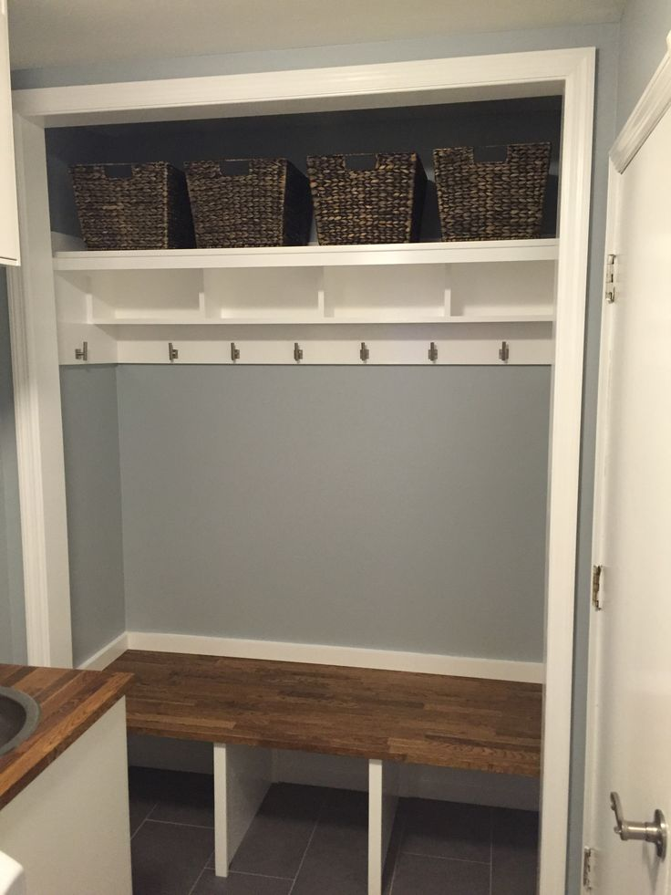 Closet mudroom conversion drop zone. Storage cubbies and baskets. IKEA butcher block.