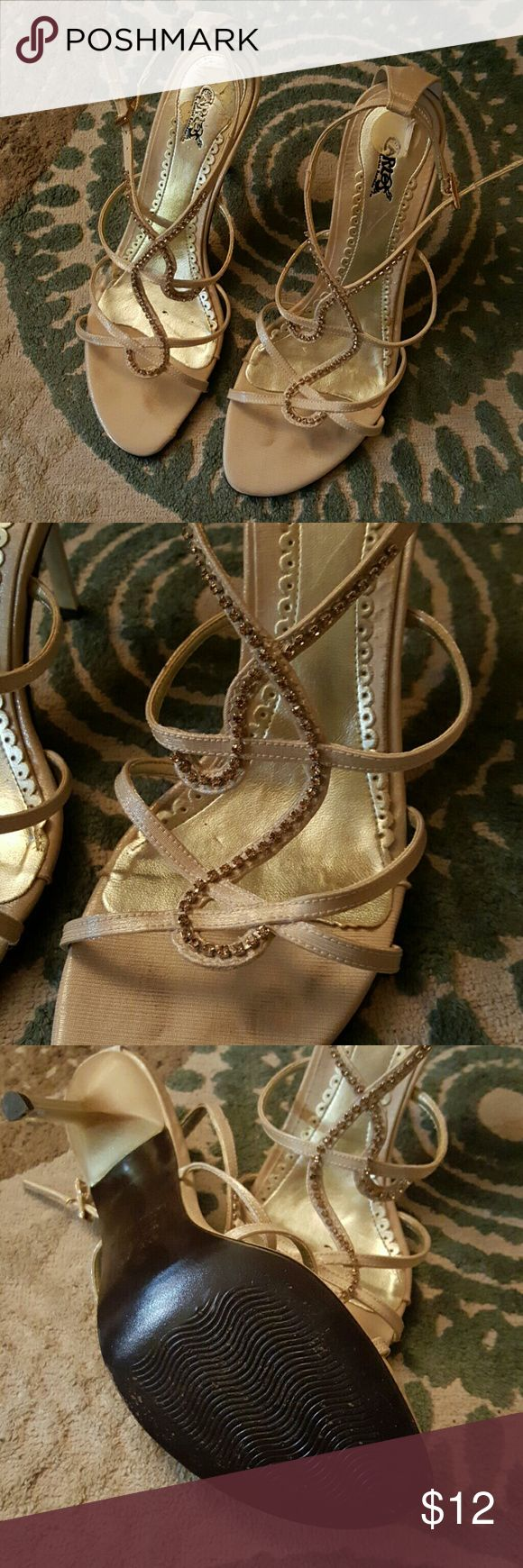 Sexy strapy bling heels Lovely gold color with gold rhinestones. Good condition. Normal wear on strap. See pic no. 4 Carlos Santana Shoes Heels