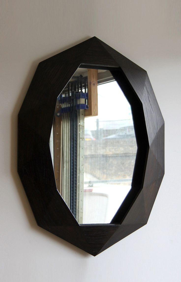 BLACK WALL  MIRROR WITH BRITISH STYLE   Inspired by British design, this black mirror is timeless and elegant   www.bocadolobo.com #wallmirrors