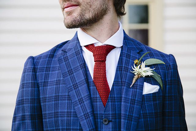 The groom wore a bespoke suit from G.A. Zink & Sons. Image: Lauren Gray Photography