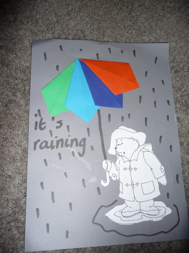 MAP : de kinderen maken de paraplu van gevouwen vliegers en kleuren het beertje. Ook tekenen ze regen....