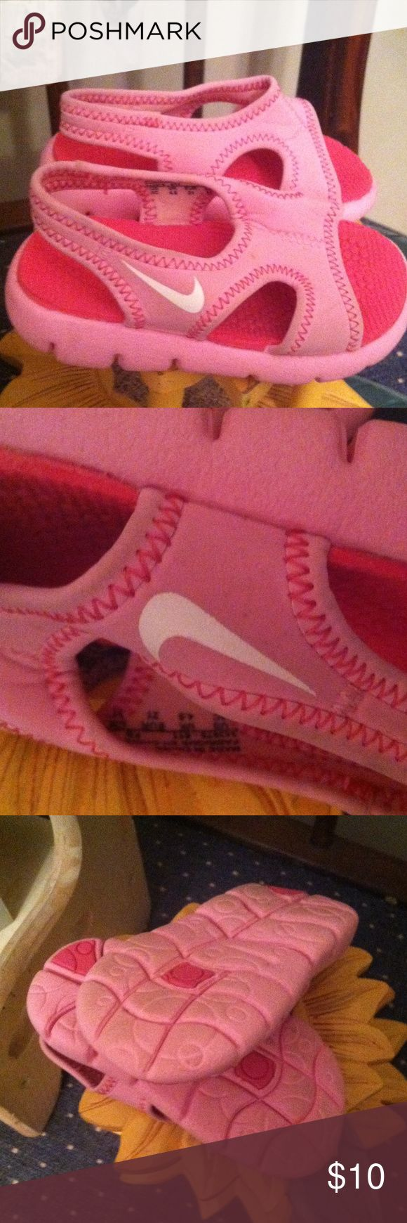 Nike water shoes sz 5 toddler Protect her feet in the pool. Nice very gently pre loved !!!  Pink nike Nike Shoes Water Shoes
