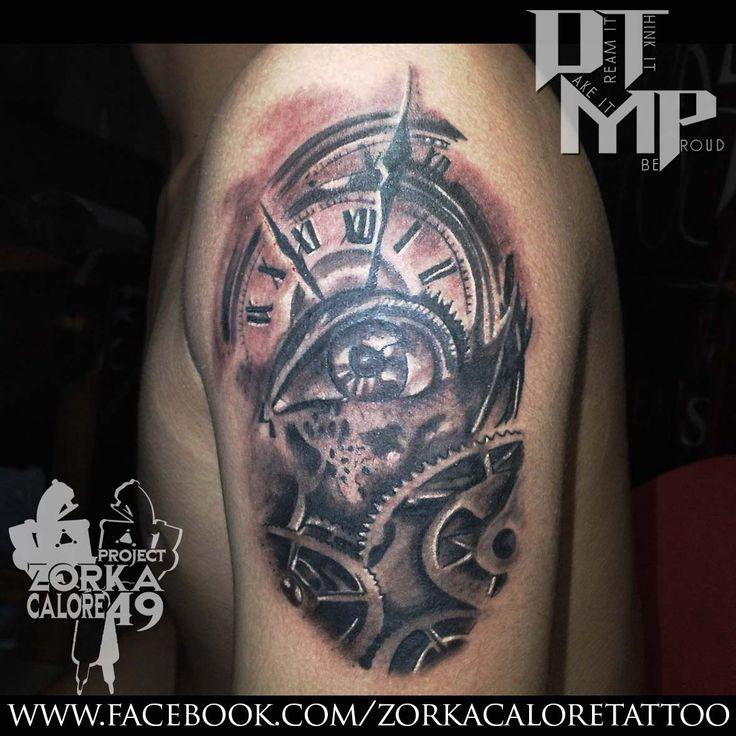 eye and clock tattoo
