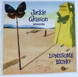 DALI, SALVADOR Jackie Gleason Lonesome echo - LP, 1955, cover by Salvador Dali Capital Records. 1955 Classic album cover by Dali, with a bl/w photograph of Gleason and Dali shaking hands, and a short explanation of the nature of the work by Dali. Lit.: Spampinato / Wiedemann, pp. 140-41 (with full-page illustration in colour); Schraenen, Vinyl - records and covers by artists, p. 35