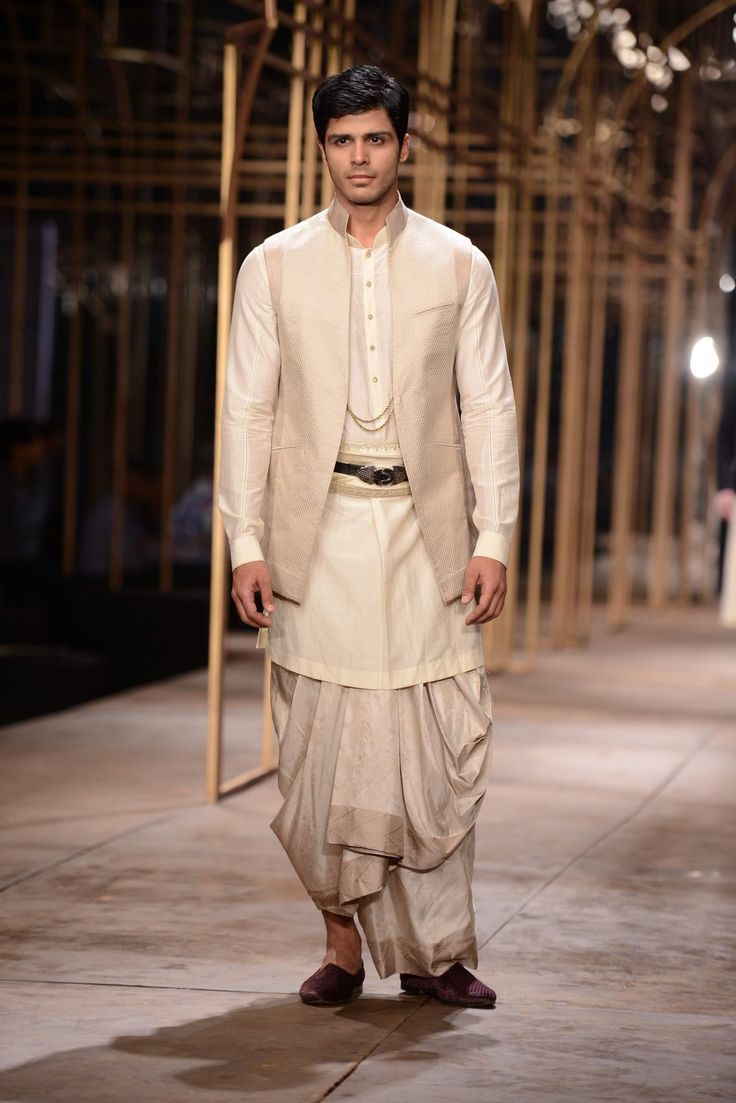 From the 2013 Tarun Tahiliani's mens bridal collection. He keeps the traditional groom in style!