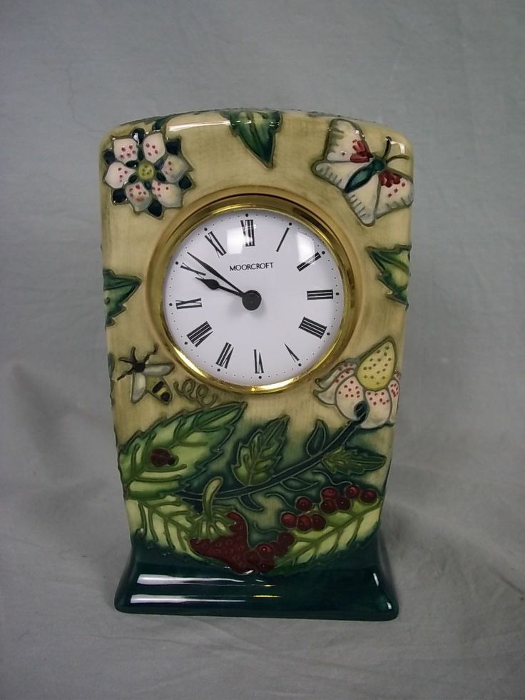 Moorcroft China Small Mantel Clock, 1999 ~  The ceramic, tube lined case is decorated with strawberries, berries, butterflies, bees and flow...