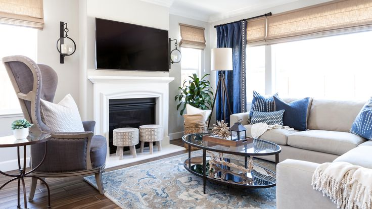 Family Room | Coastal Family Room | Gray Walls |Wingback Chair|Sectional Sofa| Blue Pillows|| Designer: Juxtaposed Interiors