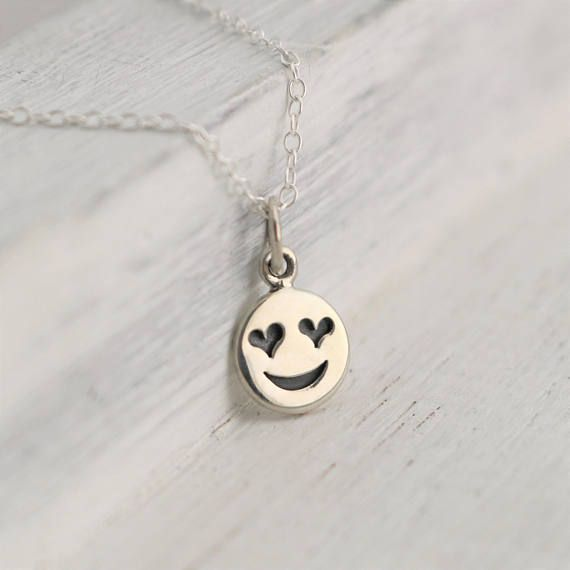 Sterling Silver Heart Eye Emoji Charm Necklace. Give this smiley face charm necklace to your best friend, partner or family member. Show your utmost affection for that special person with this sweet and silly necklace.  » Sterling Silver Heart Eye Emoji Charm with soldered jump ring