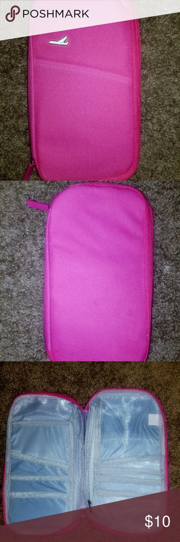 Ticket Holder/Organizer/(Airport) Color: Pink Ticket Holder/Organizer  Condition: Unused  Great way to organize and have immediate access to your ticket, credit cards, ID, and misc papers/reciepts when traveling. Inside this holder has a lot of needed pockets inserts and a pocket on the outside that can hold a mobile phone.    I have one and use it everytime I travel. It's really handy to have everything you need in your hands. It  can also be used as a wallet. Other Other