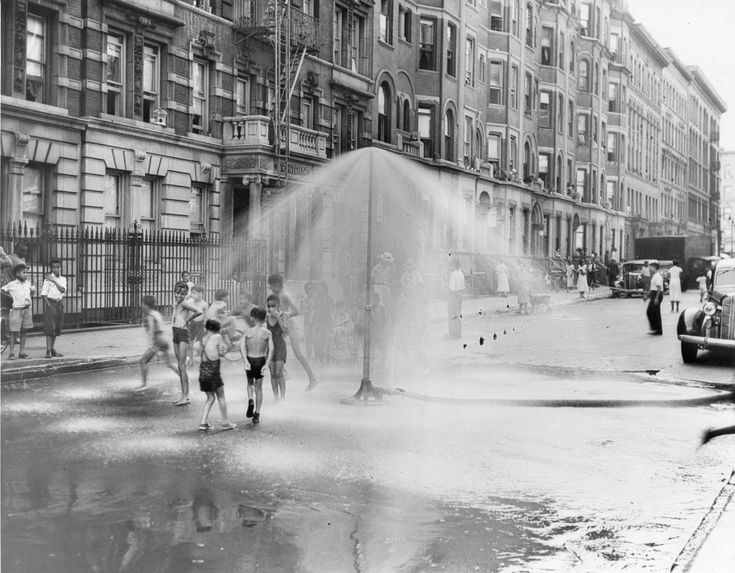 Children play in a sprinkler from a water hydrant, South Harlem, New York, New York, August 8, 1937. (Photo by PhotoQuest/Getty Images)