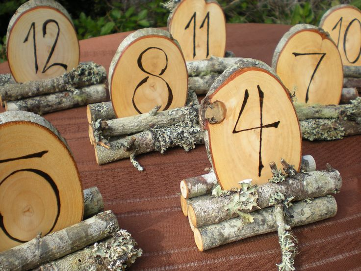 Wedding Table Numbers on Wood Slices in Branch Holder - Wood Burned. $60.00, via Etsy.