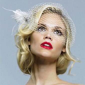 Not crazy about the red lips, but I do like the idea of just working with short hair and leaving it down with a birdcage veil.