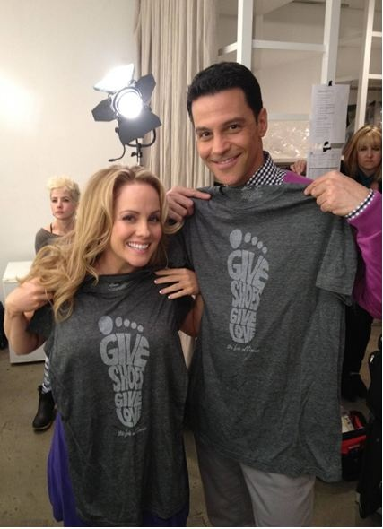 Kelly Stables & David Alan Basche of TV Land's The Exes sporting our new tshirts!    GiveShoesGiveLove.com