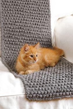 Crocheted sofa saver (kitten not included) - My cat would refuse to use this, but it'd be a cool way of covering my computer chair.