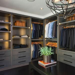 closets - bedroom turned walk-in closet, walk-in closet, glossy black floors, gray cabinetry, black hardware, gray shelv...