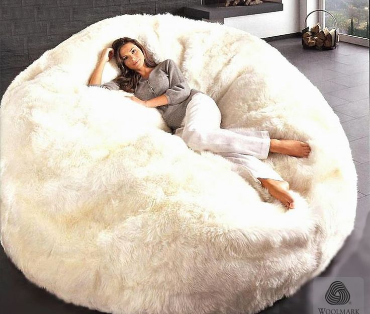 sheepskin-bean-bag-chair-jumbo  See if I could find faux fur giant bean bag instead of poor sheepskin!