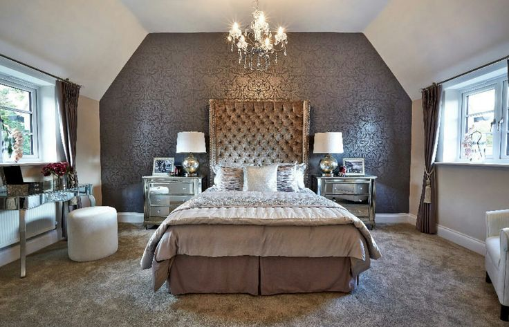 Opulent Interior Designed Master Bedroom. Metallic wallpaper, metallic velvet oversized headboard, silver mirrored bedside tables.   Barwood Homes 2016  #barwoodhomes #interiordesign #metallicscheme #opulentbedroom #showhomes